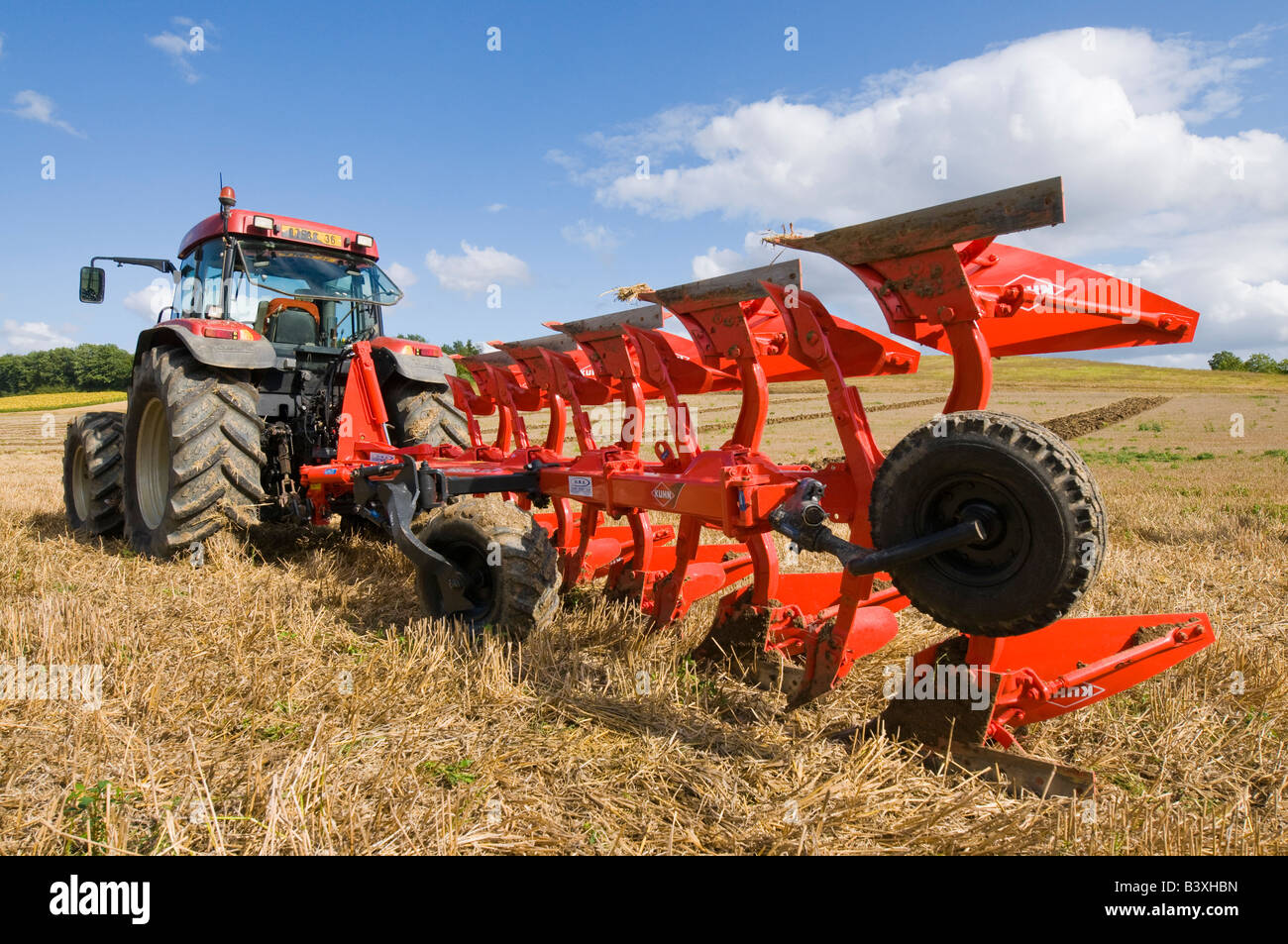 Detail of Kuhn hydraulic double plough blades, Indre-et-Loire, France. - Stock Image