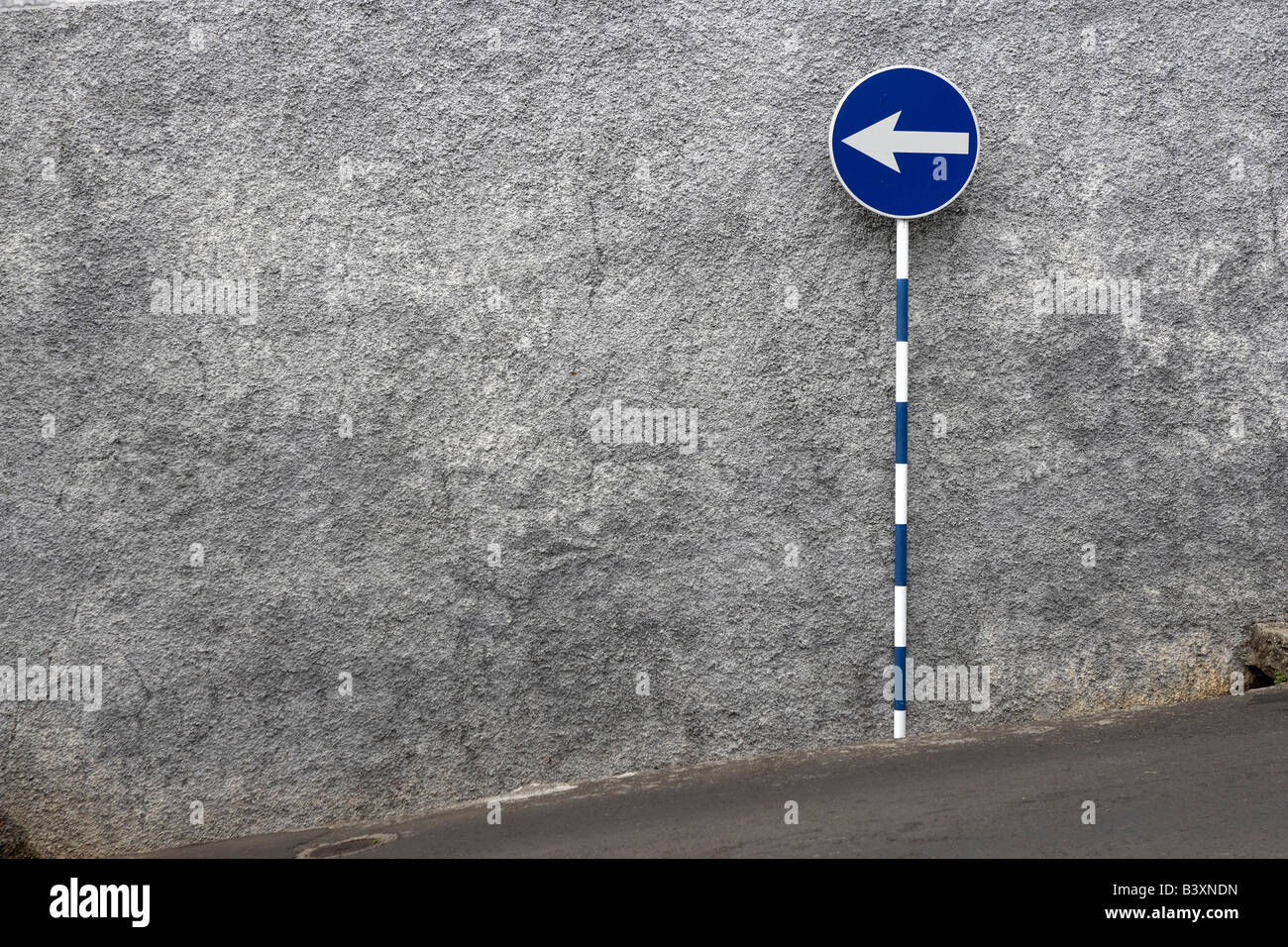 One way sign and stone wall, Madeira, Portugal. Stock Photo
