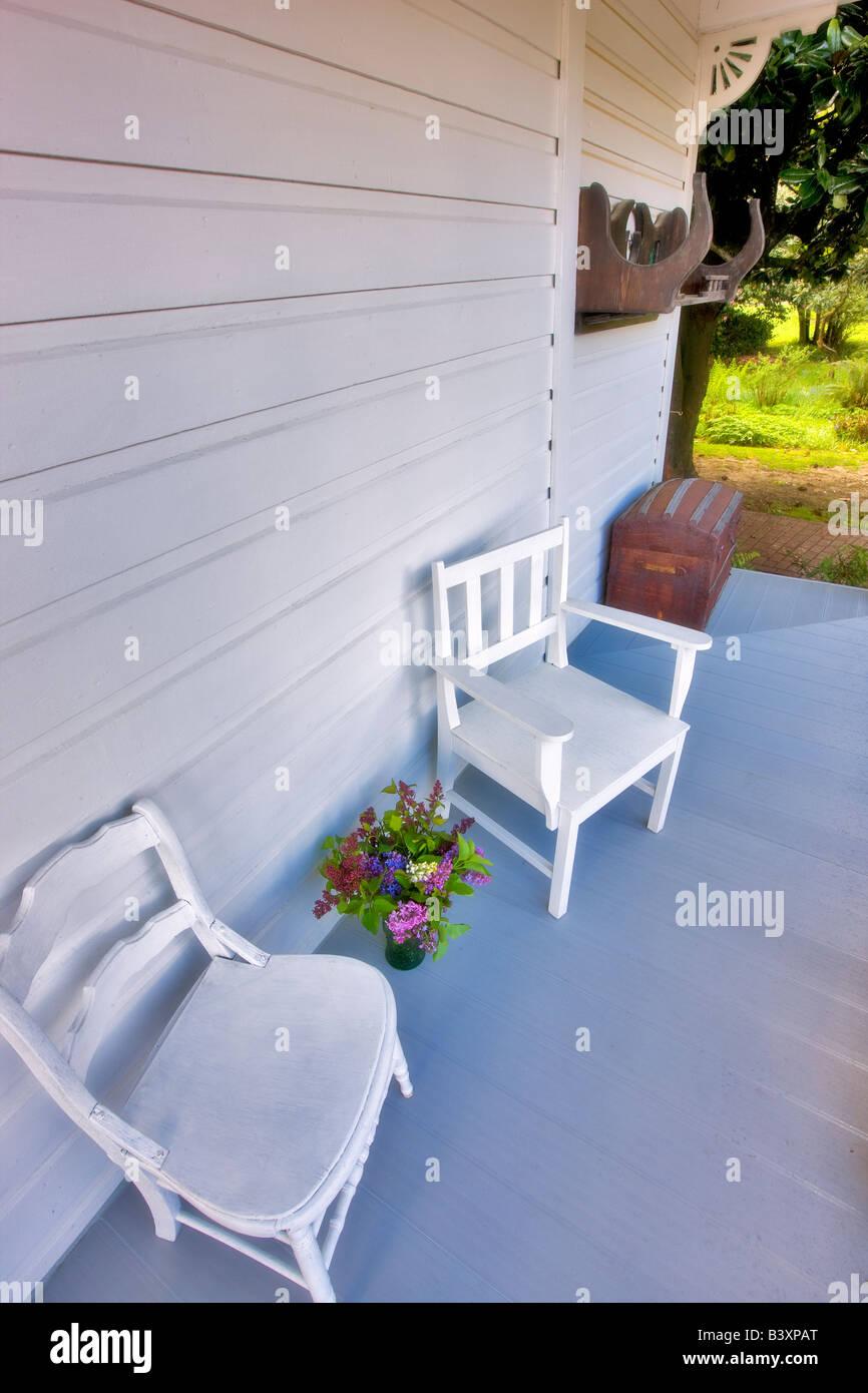 Chairs on porch at Hulda Klager Lilac Gardens Woodland Washington - Stock Image