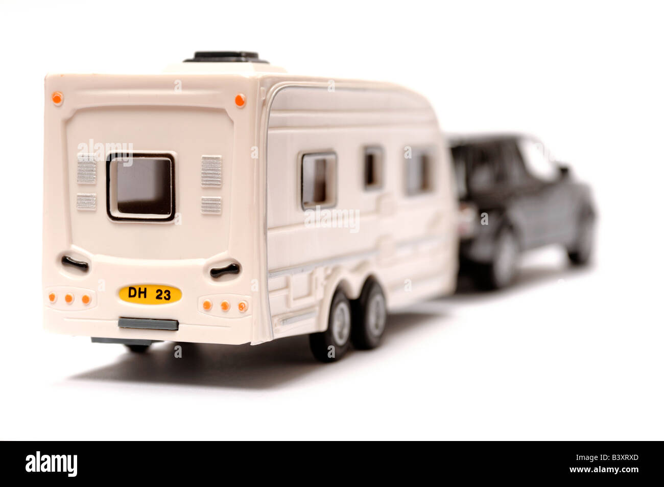 Plastic toy car and caravan Stock Photo
