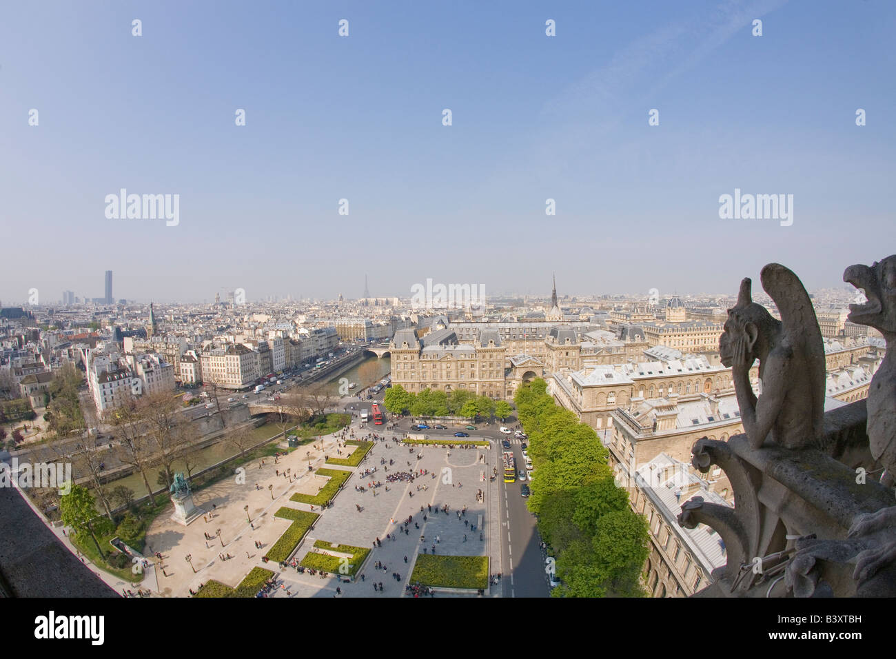 View of Paris from the Chimera Gallery with gargoyles Notre Dame Cathedral in spring sunshine France Europe EU Stock Photo