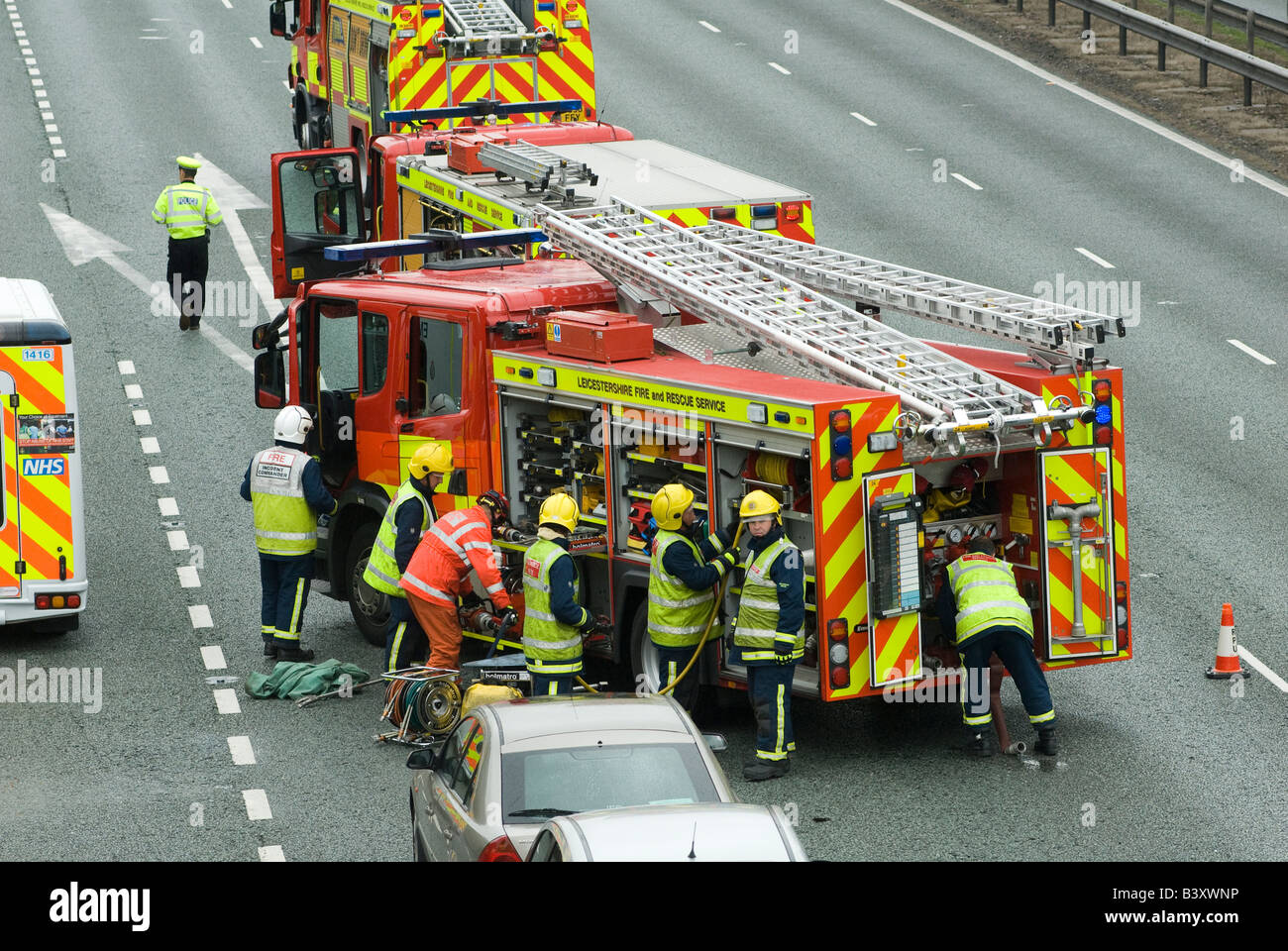 Emergency services attending a nasty road traffic accident on the m1 motorway in the midlands uk - Stock Image