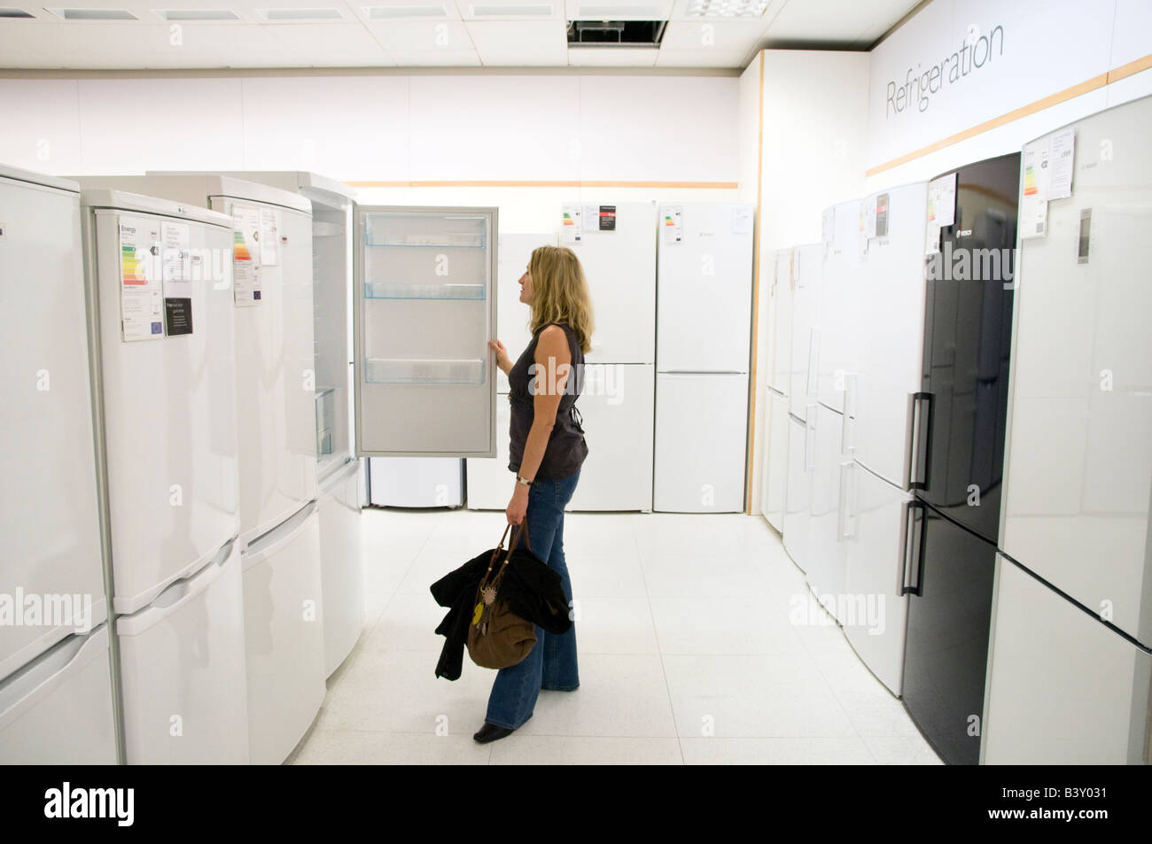 Woman buying a new refrigerator at John Lewis, London, England UK Stock Photo