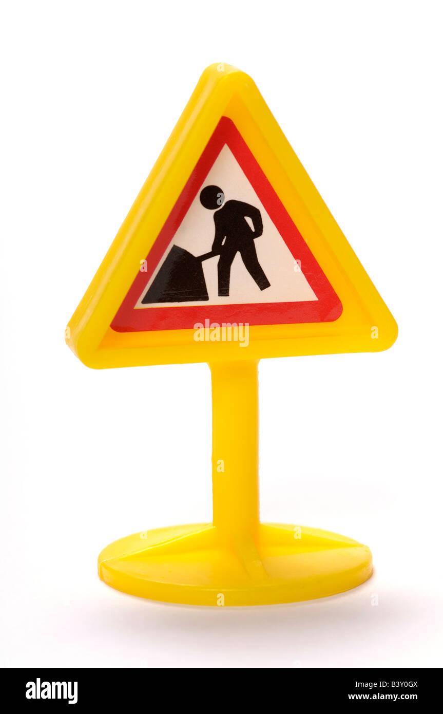 Plastic toy workmen sign - Stock Image