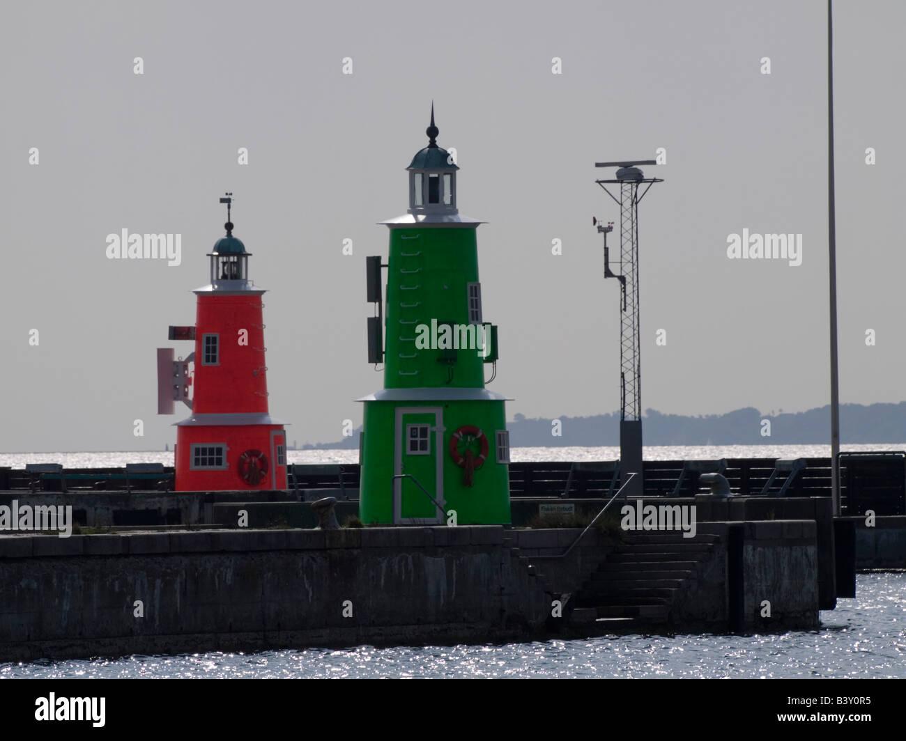 Twin Beacons on the breakwater entrance to the Port of Helsingoer, Denmark. - Stock Image
