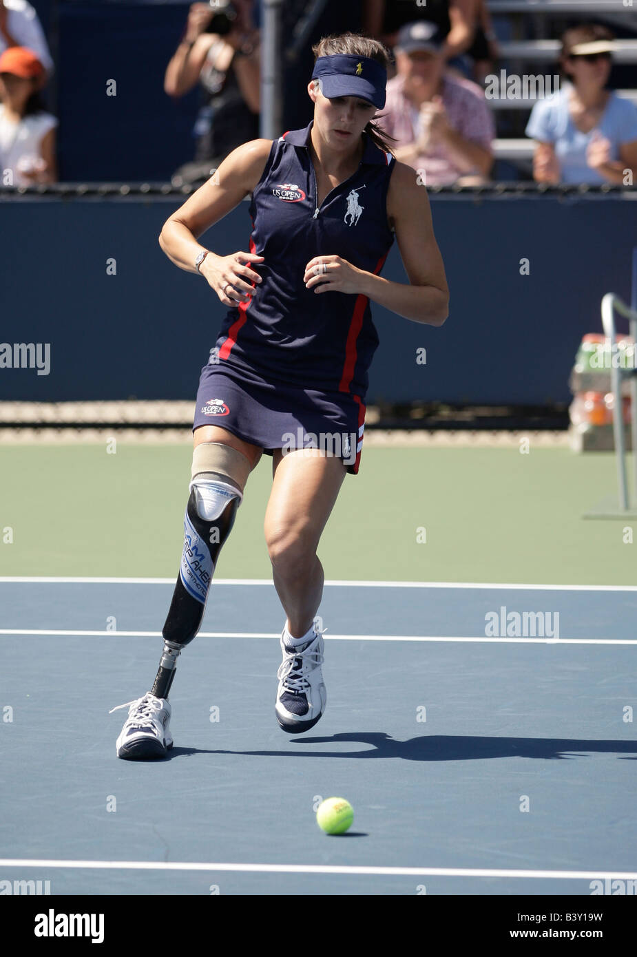 Handicapped ball girl Kelly Bruno(24) sprints across the court at the US Open Tennis Championships to pick up a - Stock Image