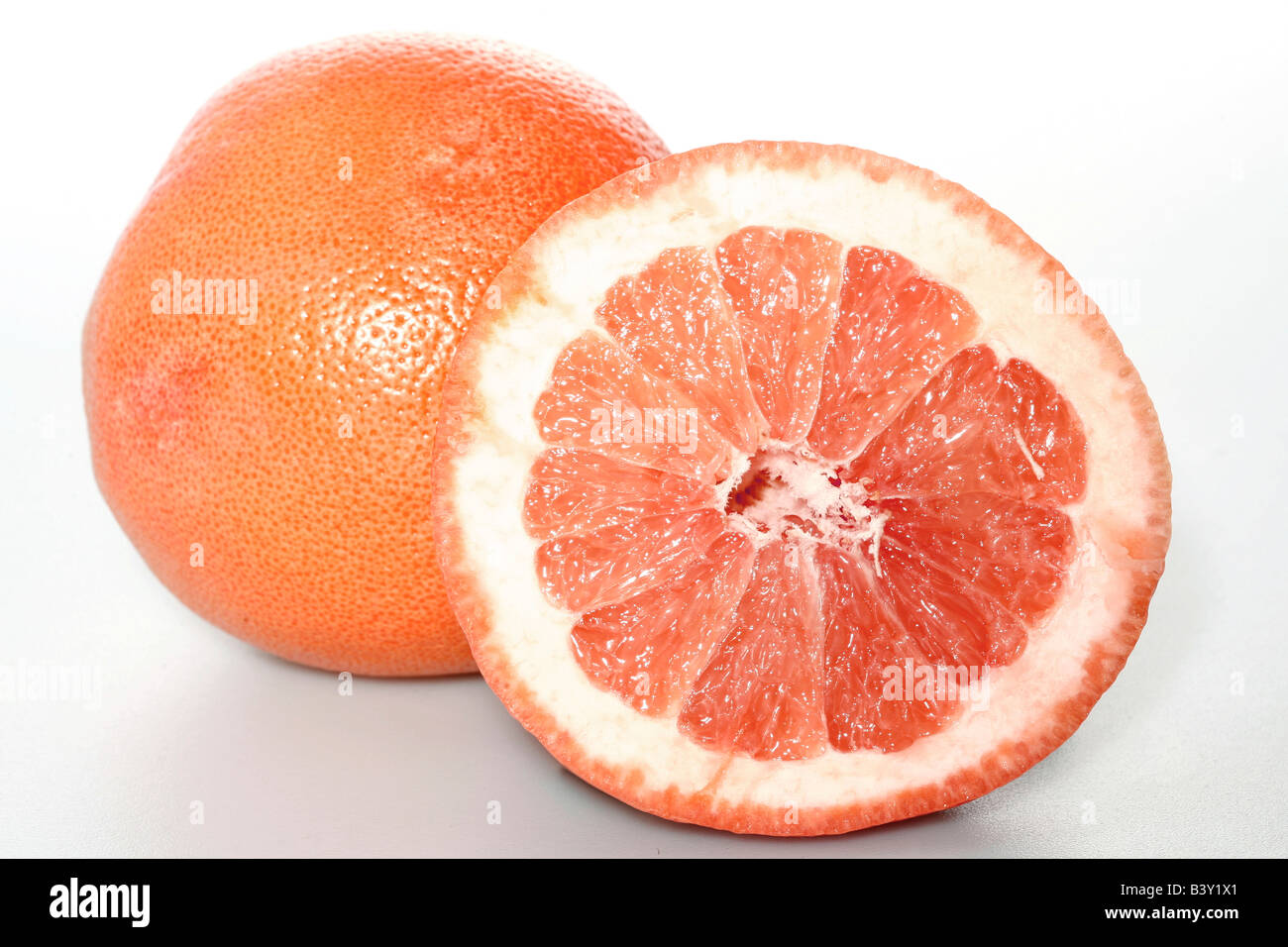 Close up of a Grapefruit and a slice - Stock Image
