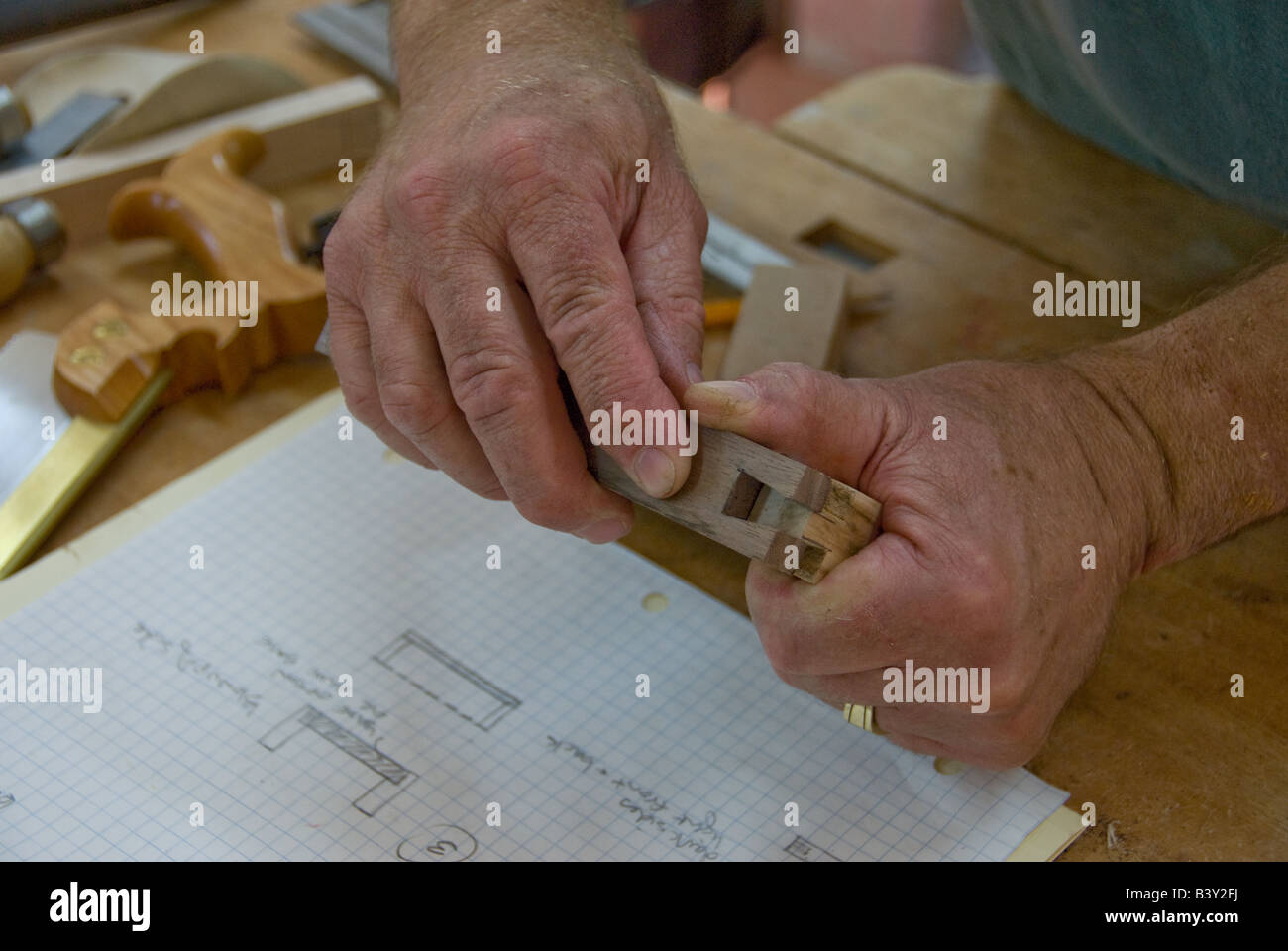 carpenter man working with wood with close up of hands - Stock Image