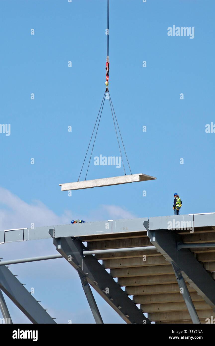 Lowering the terraces onto Arsenal's new Emirates stadium during construction Holloway London England UK - Stock Image