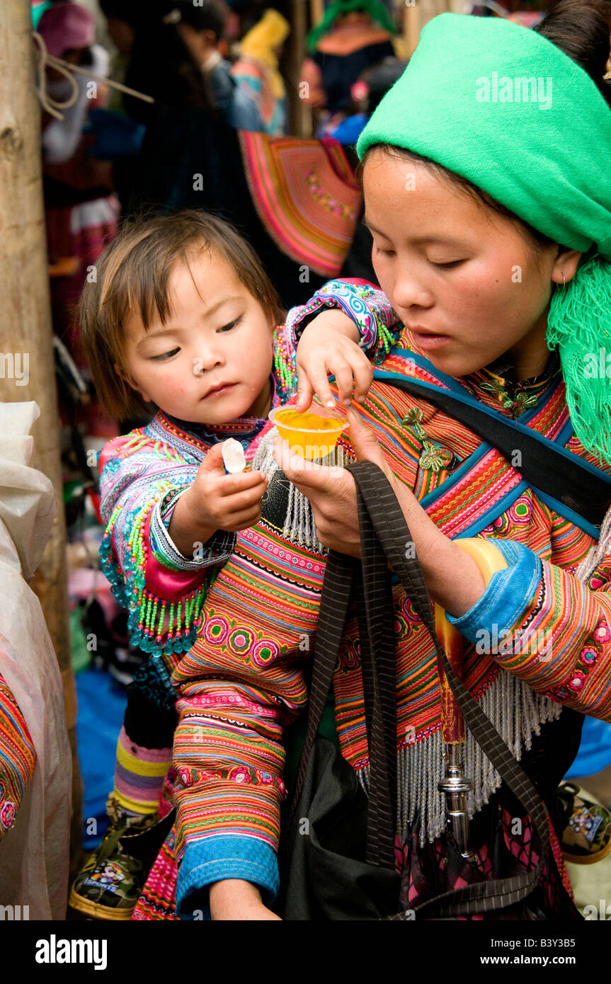 A Flower Hmong Mother Carrying Her Baby On Her Back In
