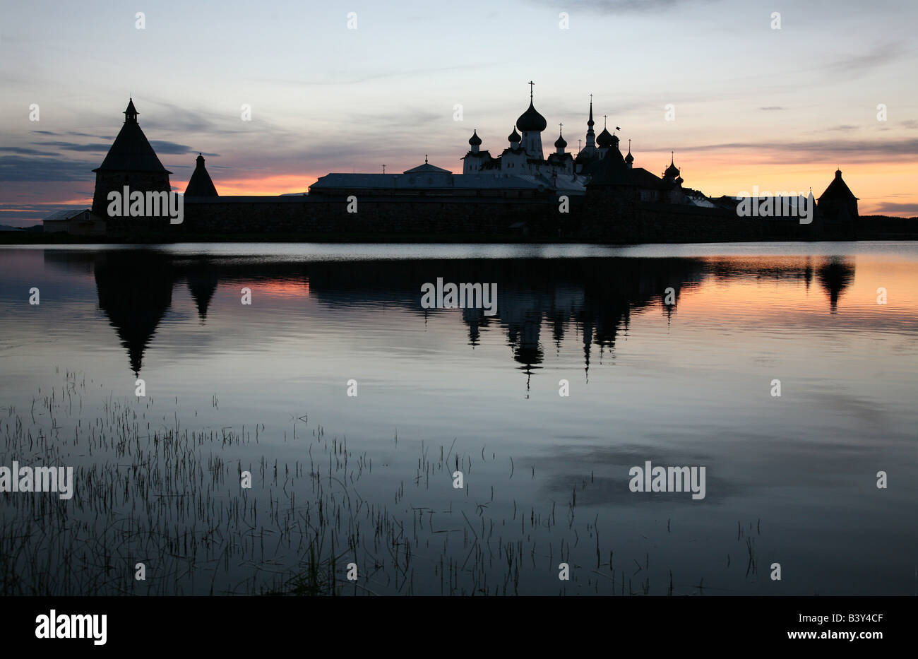 Solovetsky Monastery on the Solovetsky Islands in the White Sea, Russia. View from Saint Lake at sunset Stock Photo