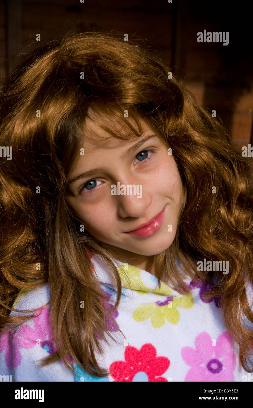 girl child with auburn wig - Stock Image