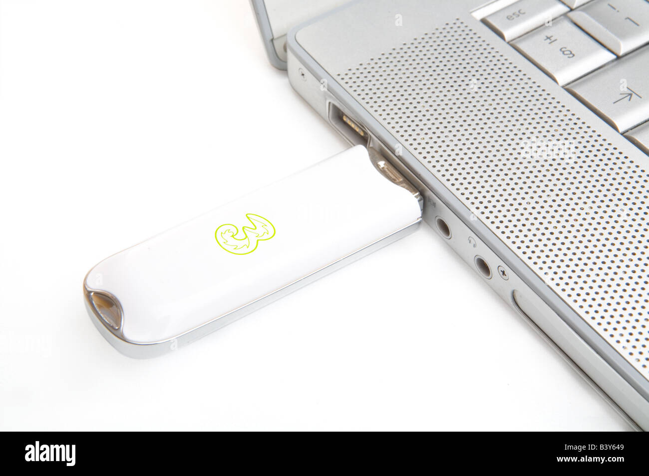 A Three Mobile wireless dongle in a MacBook Pro Stock Photo