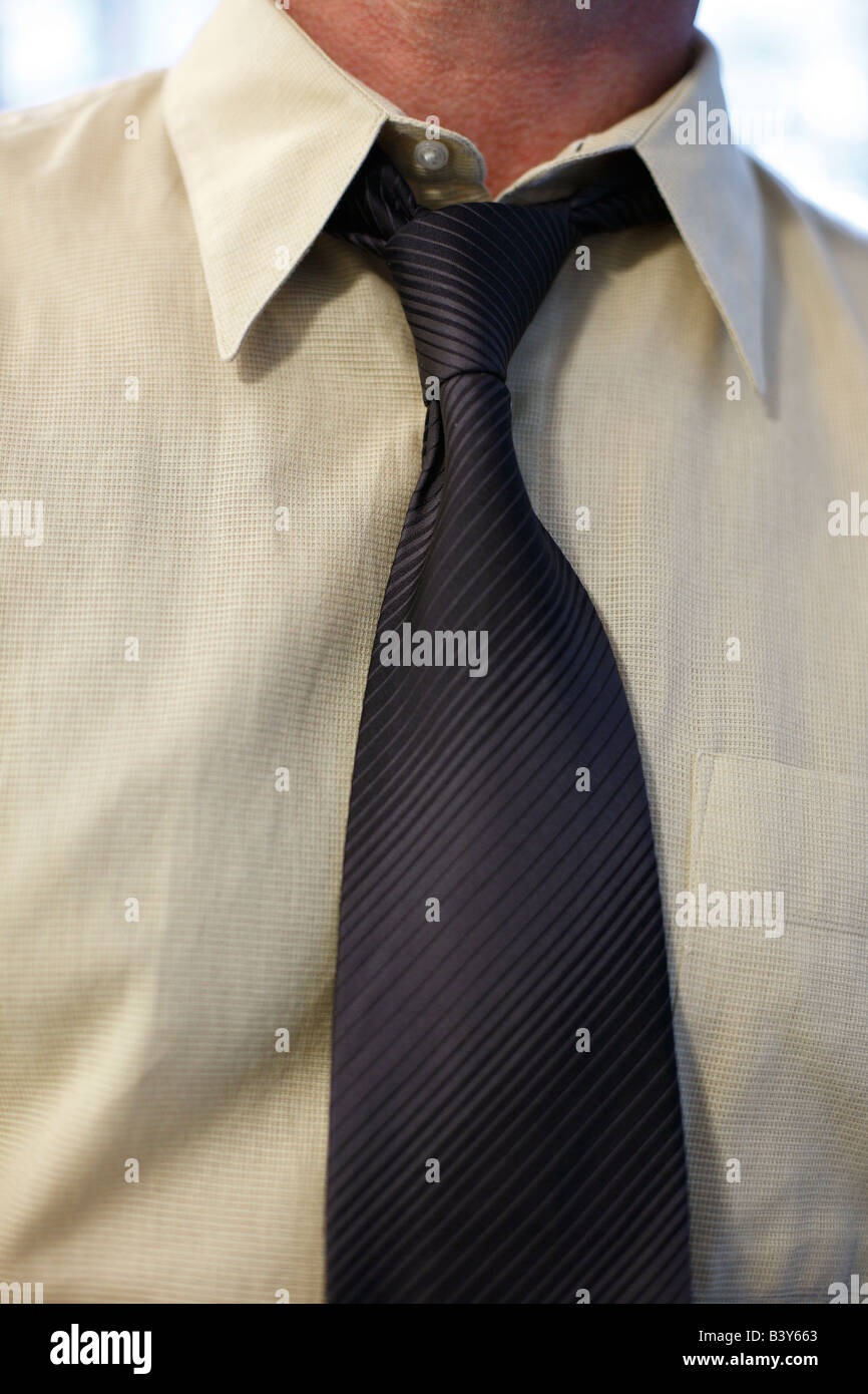 Close up of man s neck and loosened tie - Stock Image
