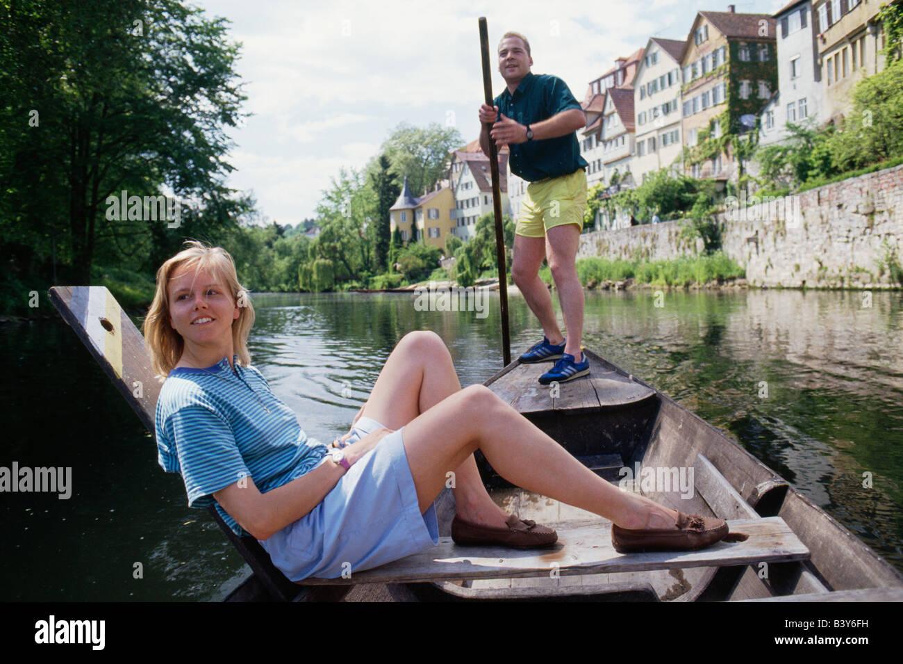 University students Punting (boating) on the Neckar river, TŸBINGEN, Germany - Stock Image