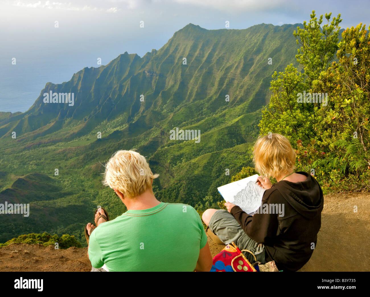 Kalalau Valley with artists drawing scene Koke e State Park Waimea Canyon Kauai Hawaii - Stock Image