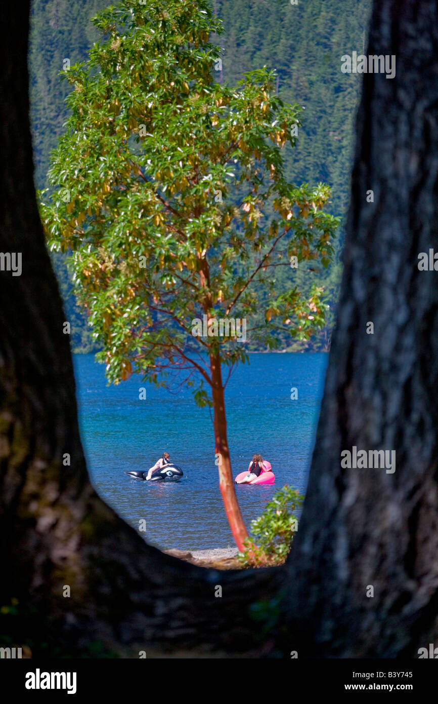 Girls palying in Lake Crescent Olympic National Park Washington - Stock Image