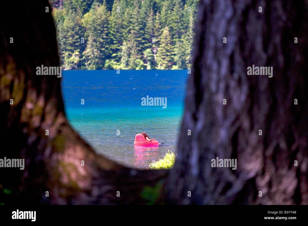 Girl palying in Lake Crescent Olympic National Park Washington - Stock Image