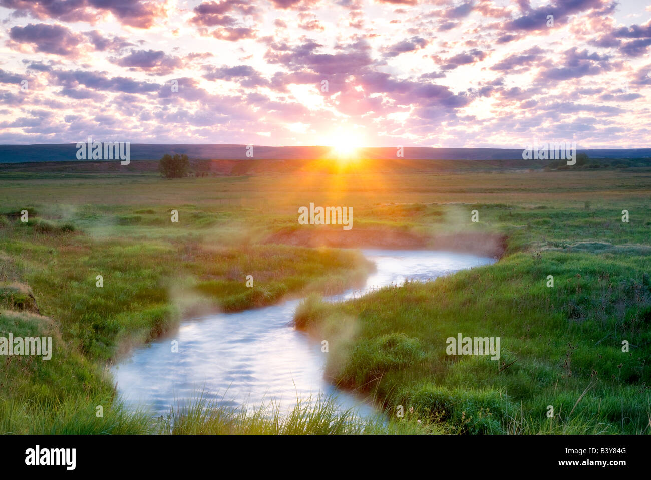 Sunrise with Prairie Creek Wallow County Oregon Stock Photo