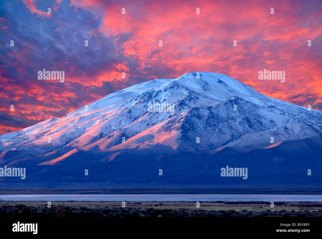 Pueblo Mountain at sunrise OregonClouds over Alpine Oregon Sky has been added - Stock Image