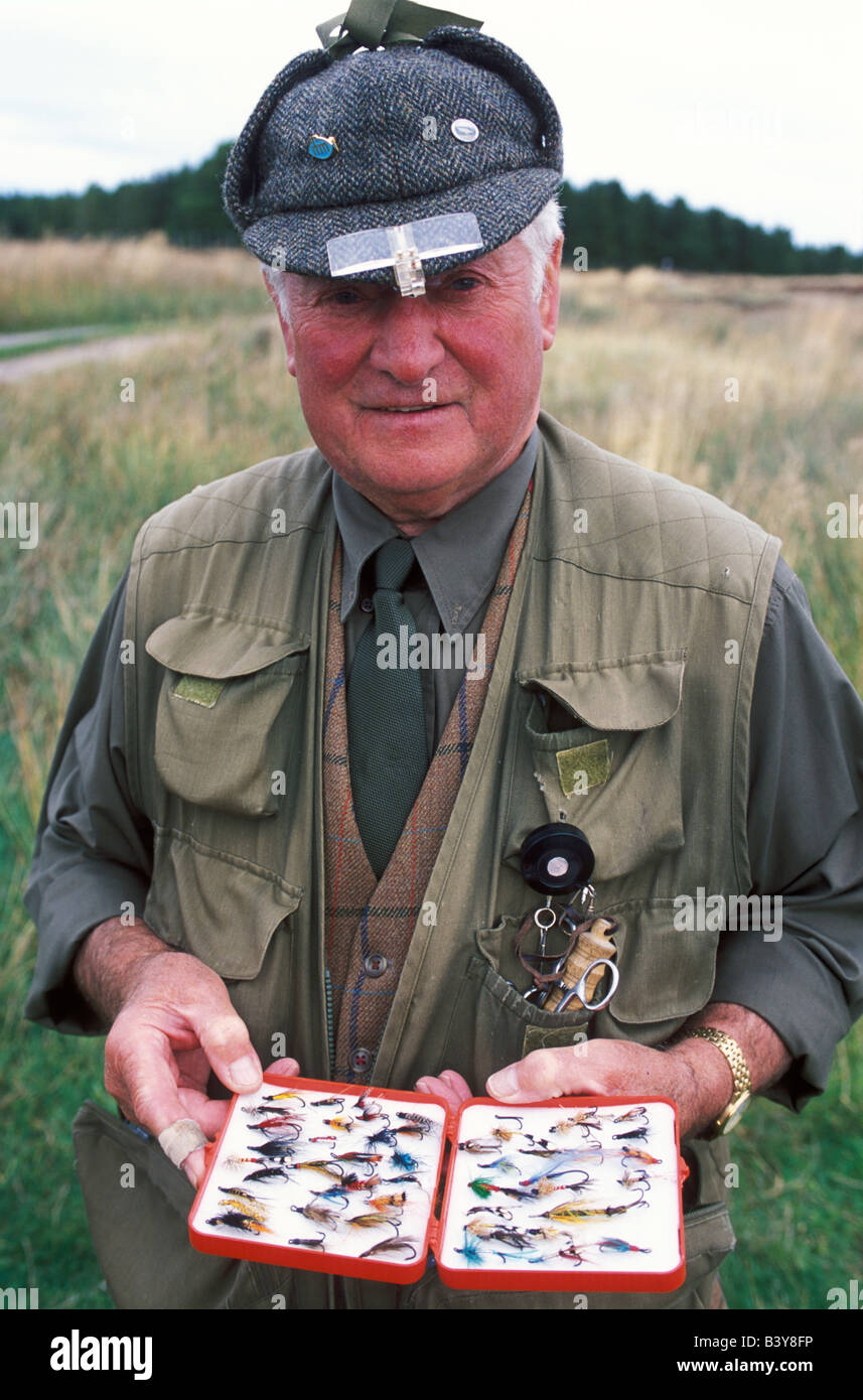 Scotland, Caithness, Ackergill Tower. Jimmy Sutherland the Ackergill ghillie with a box of salmon flies Stock Photo