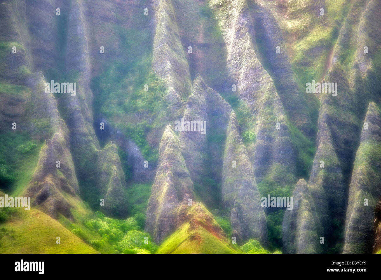 Jagged peaks in fog off Napali Coast Kauai Hawaii - Stock Image