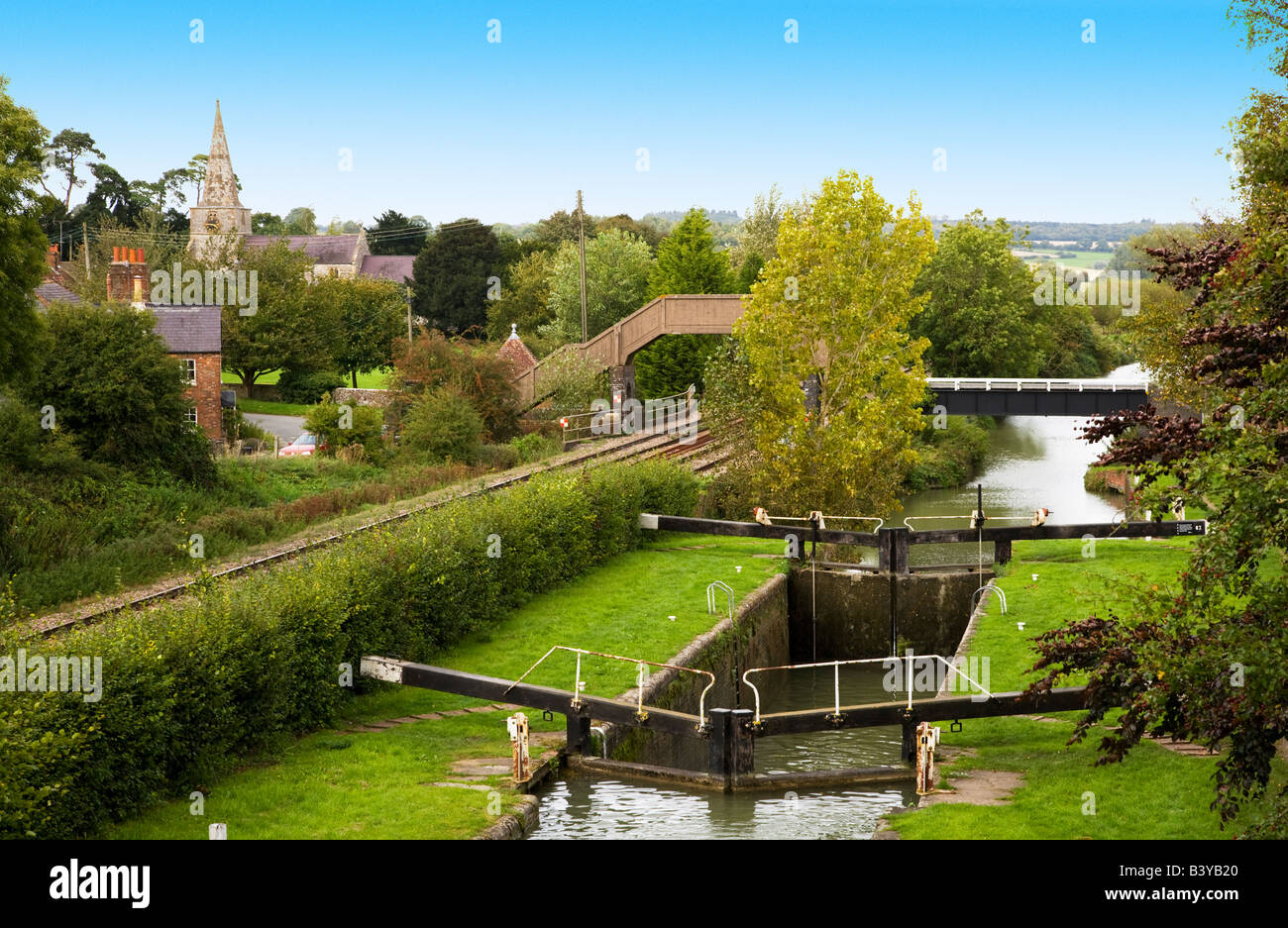 Lock at Little Bedwyn on the Kennet and Avon Canal with village and church in the distance.  Wiltshire, England, - Stock Image