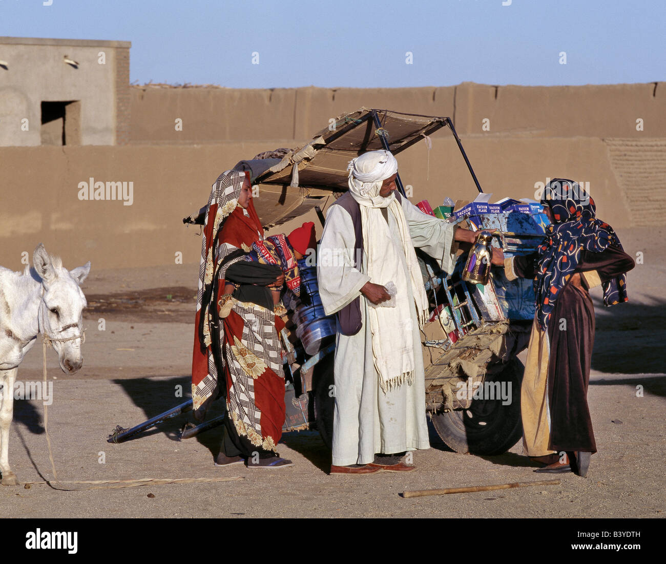 Sudan, Sahara Desert, Soleb. A merchant plies his trade from a donkey cart in the small village of Soleb, close - Stock Image