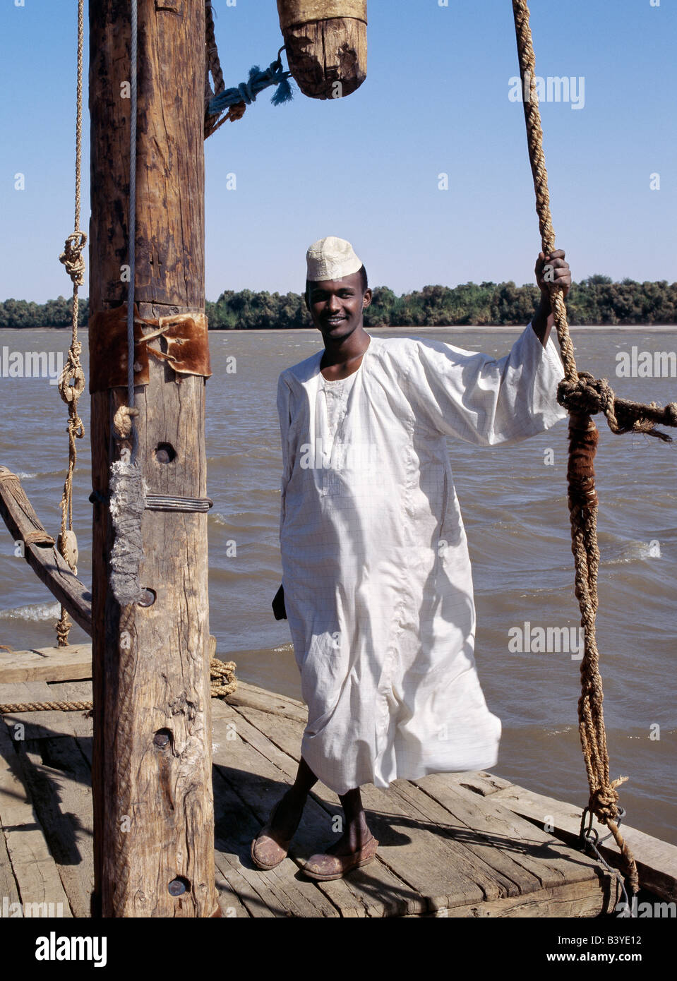 Sudan, Delgo. A Nubian boatman on his felucca, a wooden sailing boat that plies the waters of the River Nile in - Stock Image