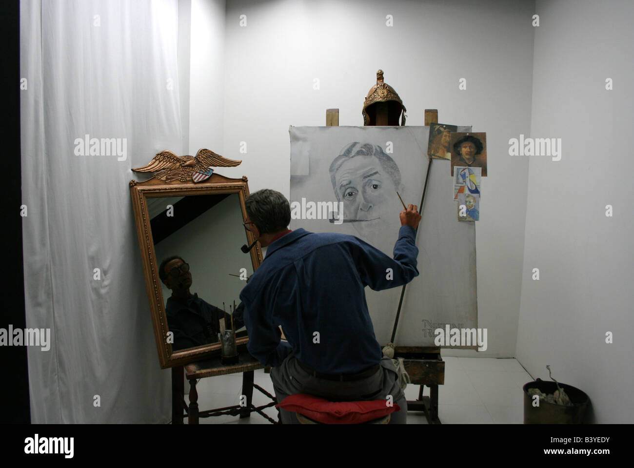 Wax recreation of Norman Rockwell doing a self portrait in mirror - Stock Image