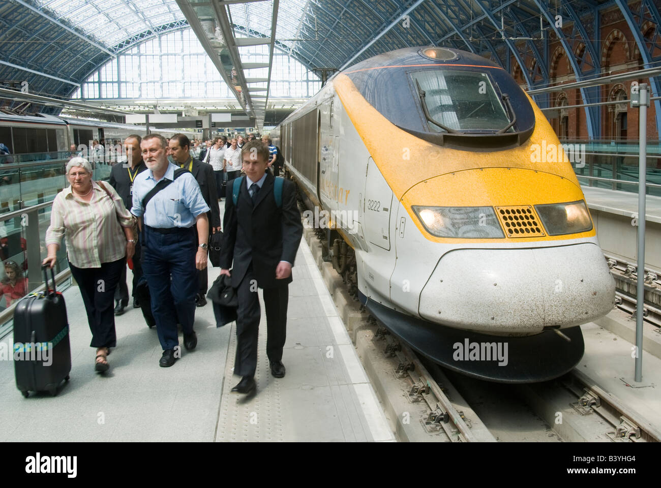 Passengers disembarking from the Eurostar train service at St Pancras International Railway Station England - Stock Image