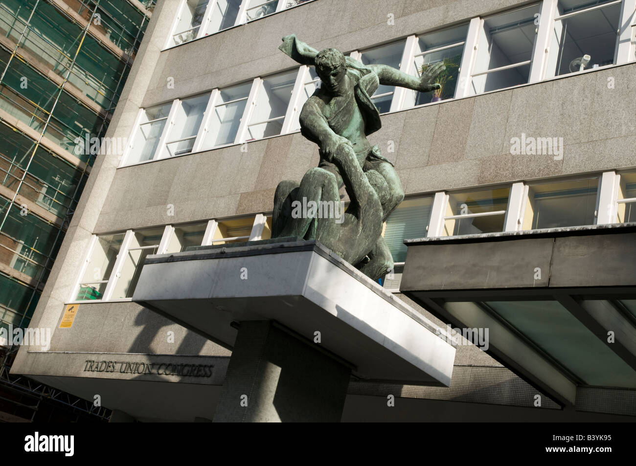 'The spirit of trade unionism' sculpture by Bernard Meadows outside Trades Union Congress building London - Stock Image