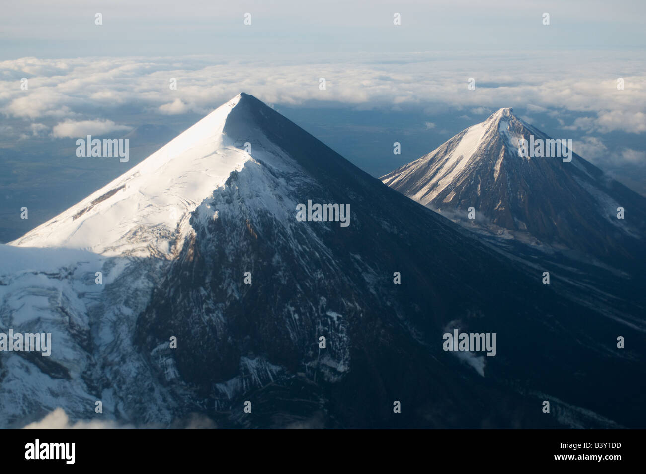 Pavlof Volcano, 8264 feet (2519 m.) with Pavlof Sister behind, Aerial, September 2007 - Stock Image