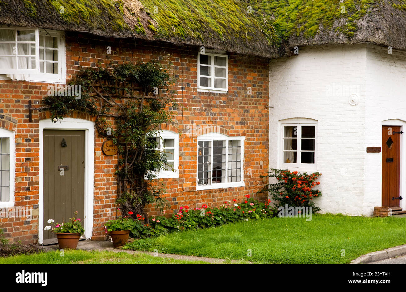 Typical thatched country village cottage in rural Little Bedwyn,  Wiltshire, England, UK - Stock Image