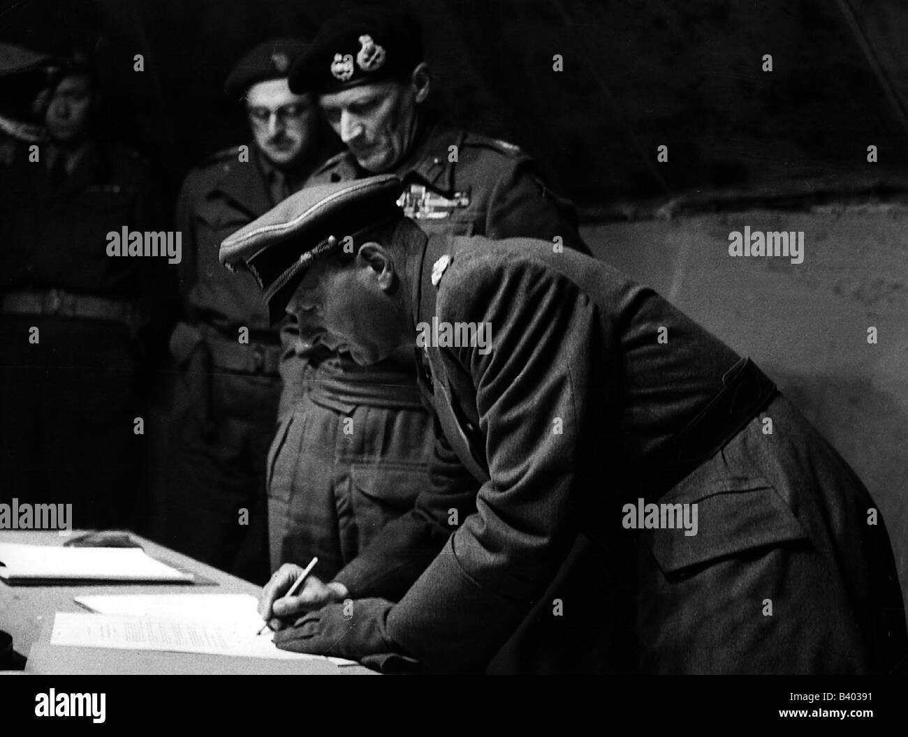WWII photo Keitel signs the act of unconditional surrender 248