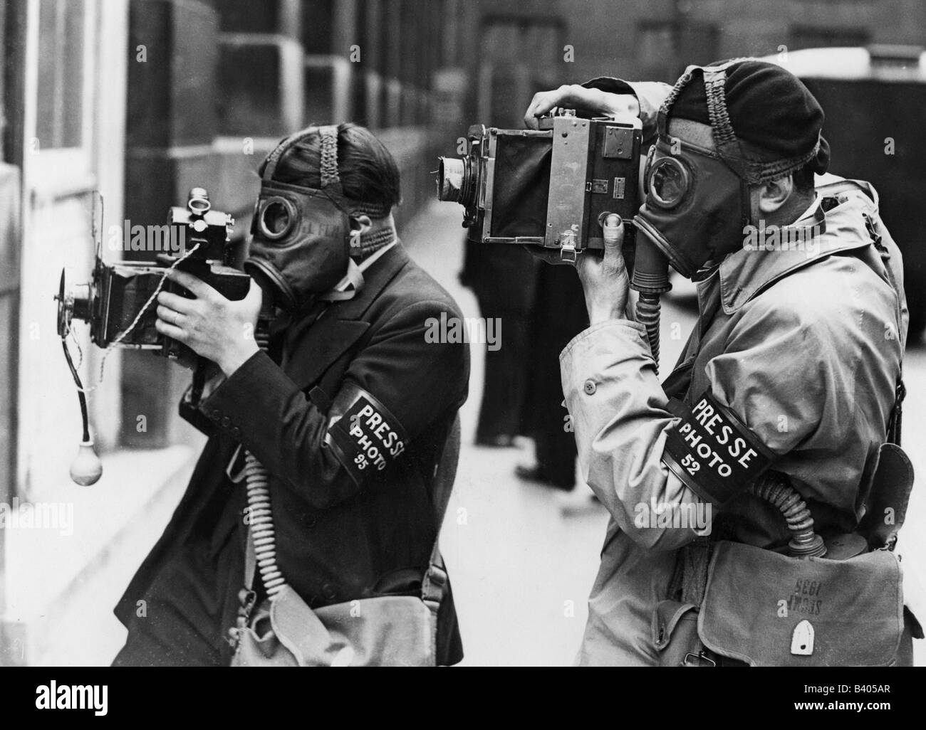 politics, civil defence, two photographers with gas masks during a civil protection drill, France, 1936, Additional - Stock Image