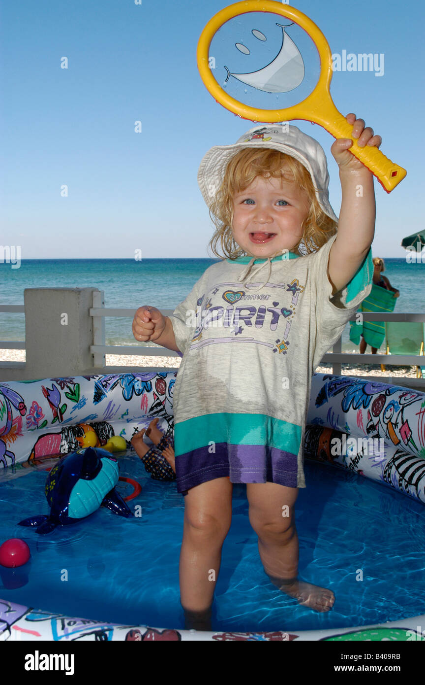 Child playing in a pool Stock Photo