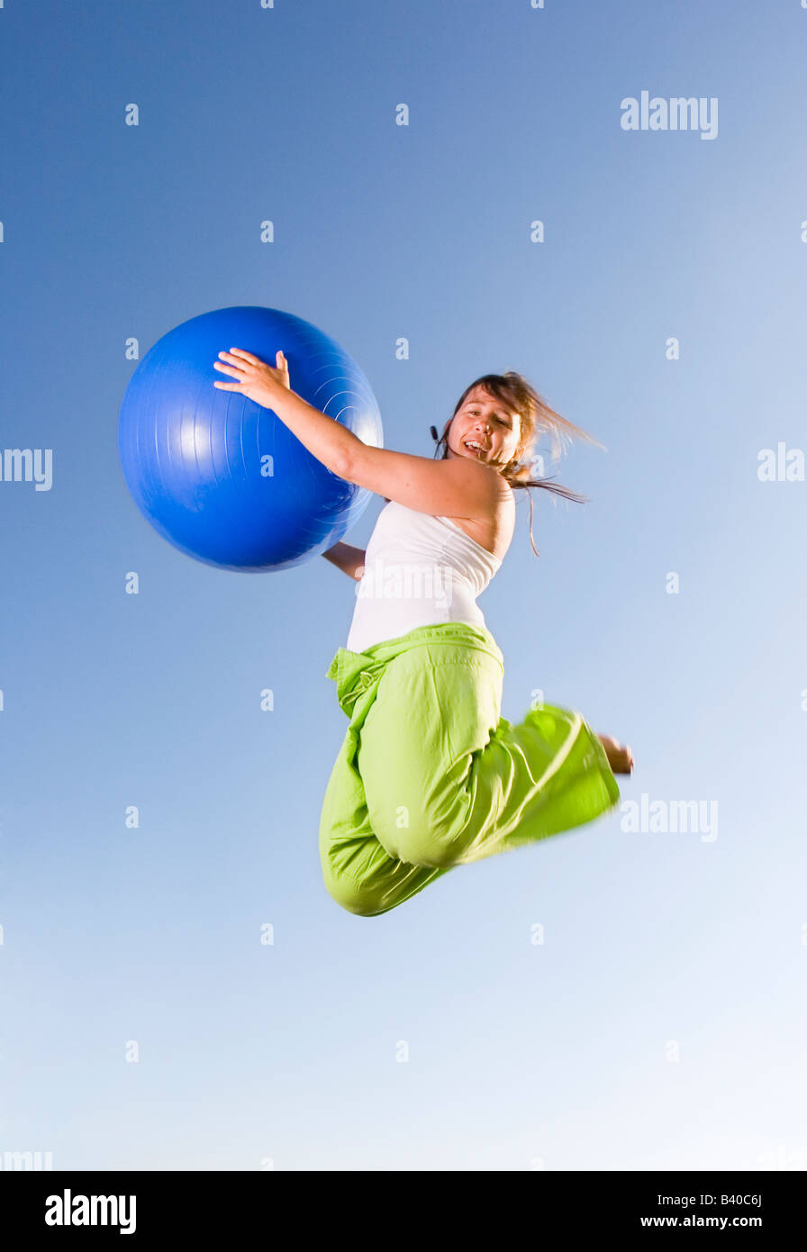 Girl jumping free air, Stock Photo