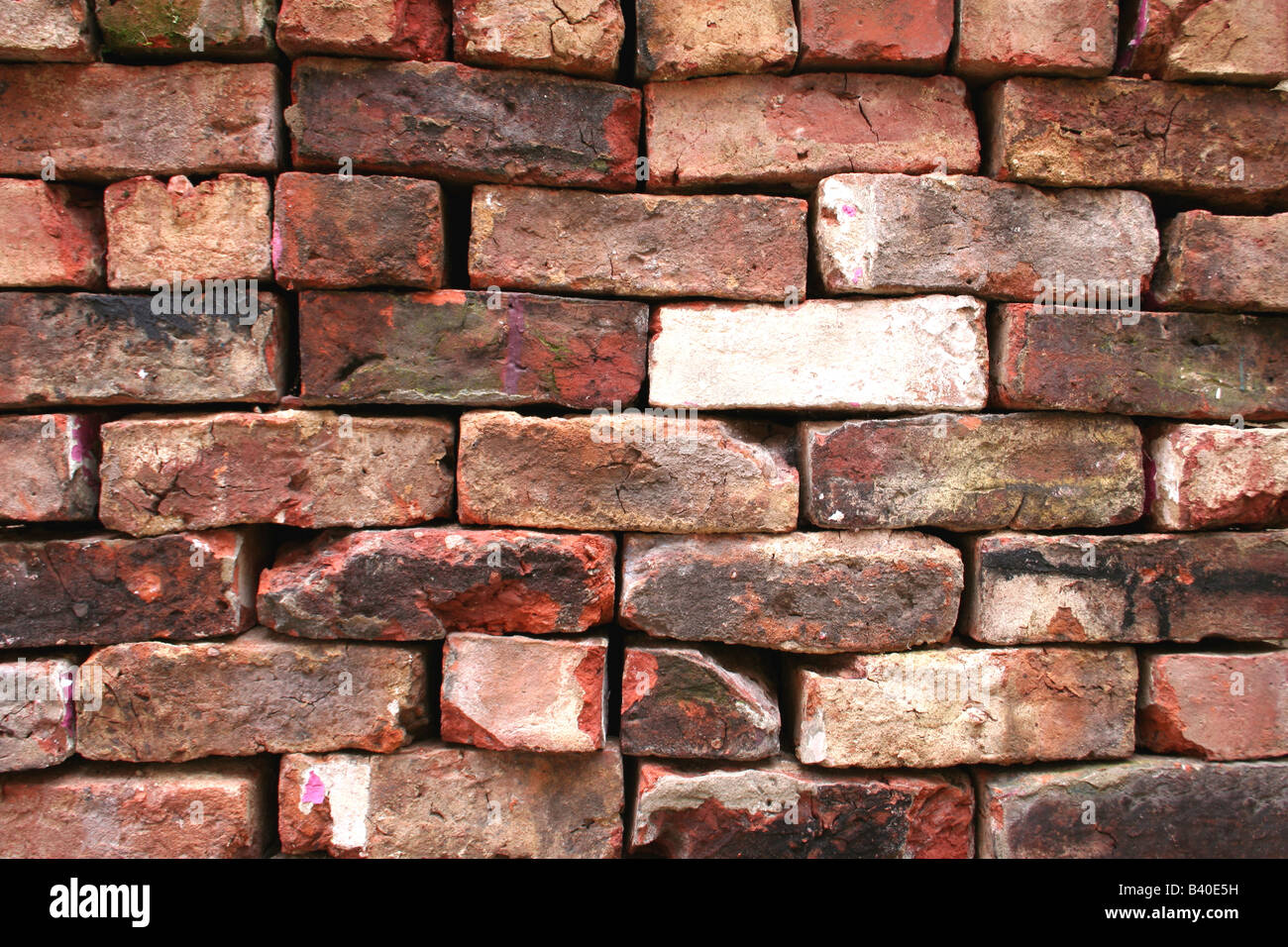 A stack of reclaimed red bricks - Stock Image