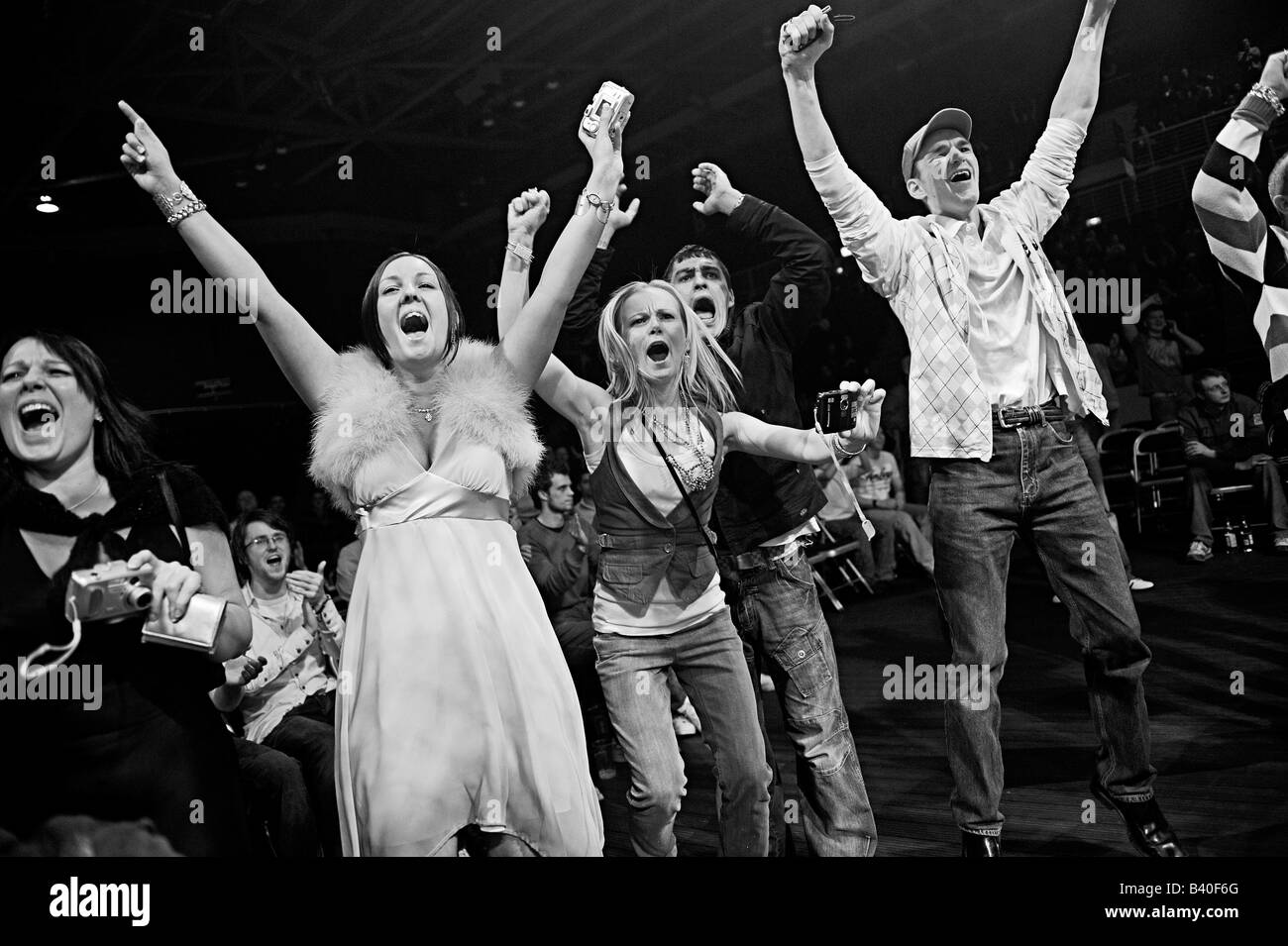 Fans celabrate during MMA Fight, Cage fight. - Stock Image