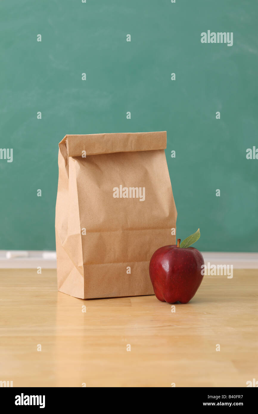 School Education Still Life With Apple And Paper Bag Chalkboard Background