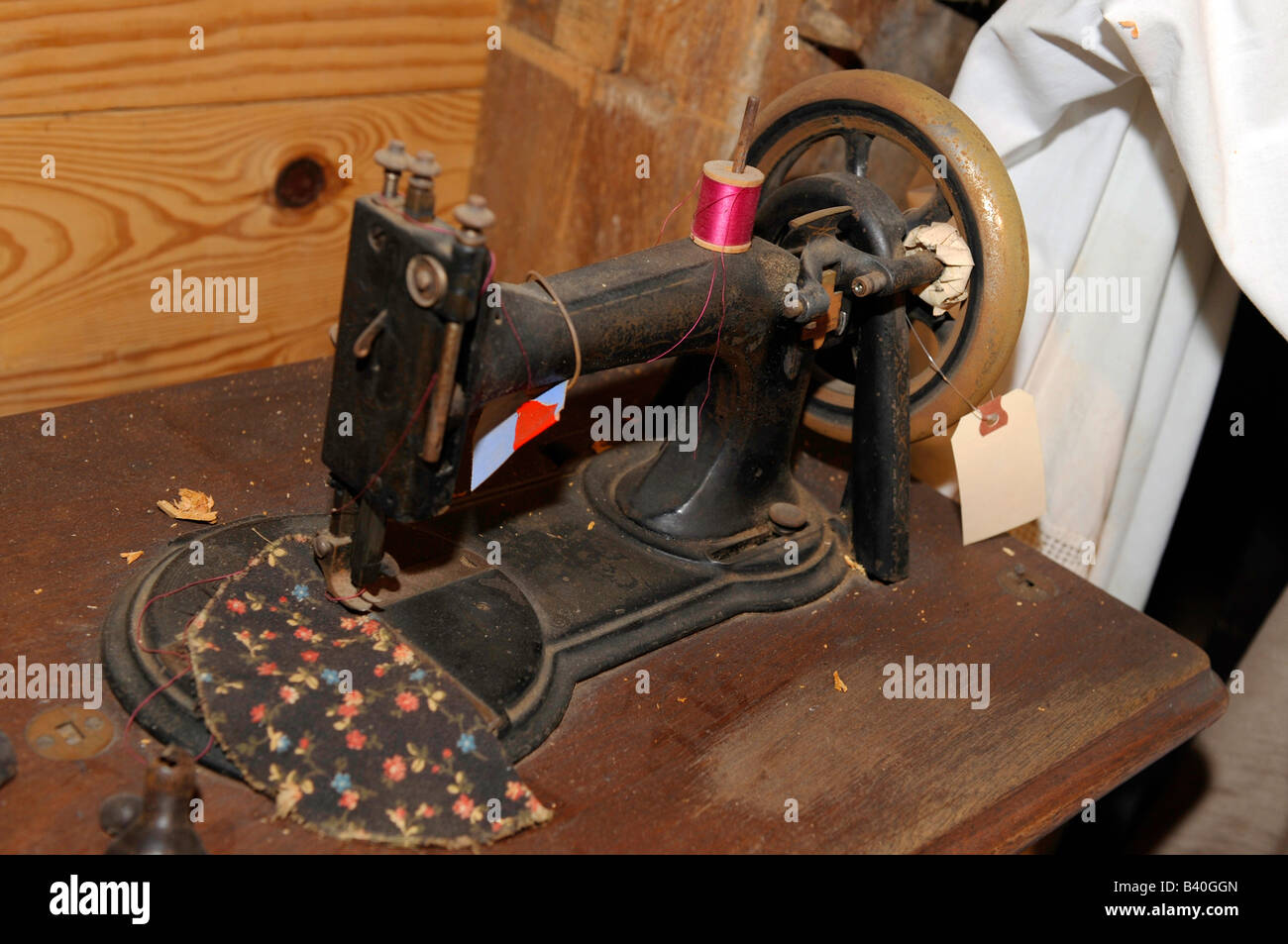 Old antique foot driven sewing machine - Stock Image
