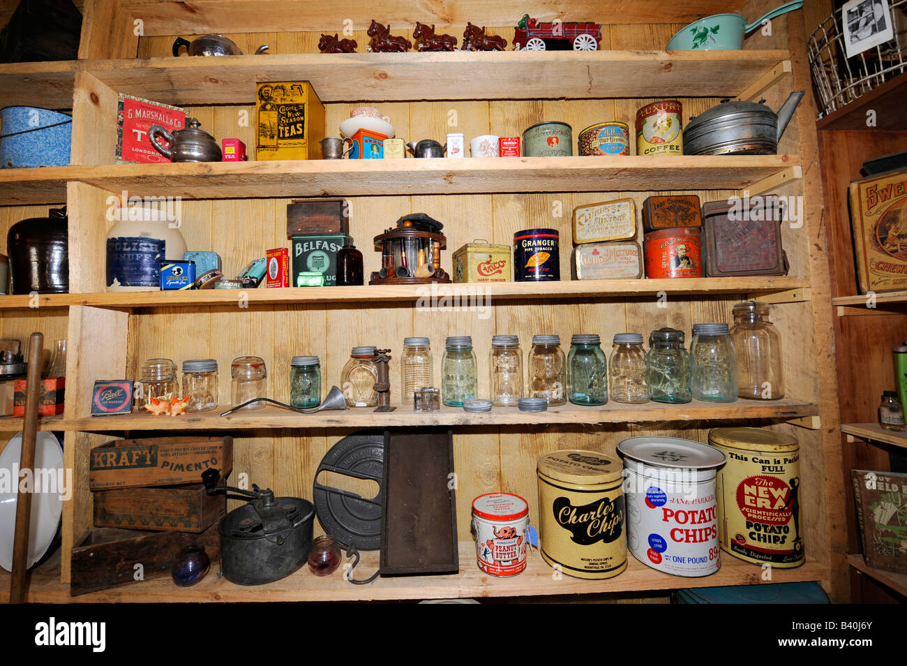 Antique products on the shelf of a historical general store setting - Stock Image