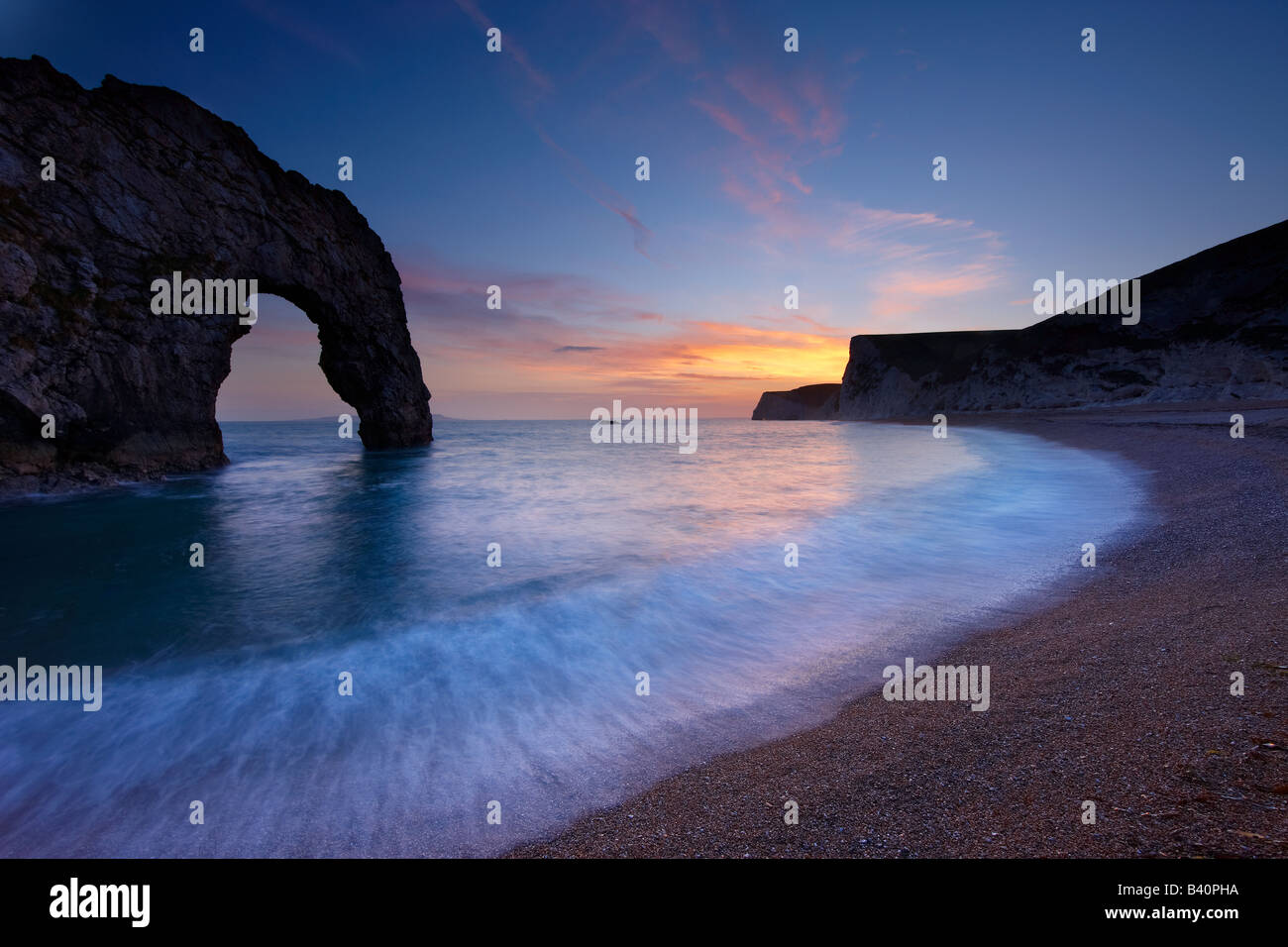 Durdle Door at dusk, Jurassic Coast (UNESCO World Heritage Site), Dorset, England, UK - Stock Image