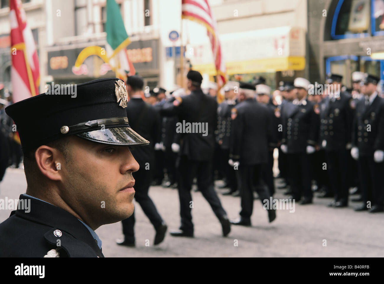 New York City firefighter views procession following funeral of fallen comrade - Stock Image