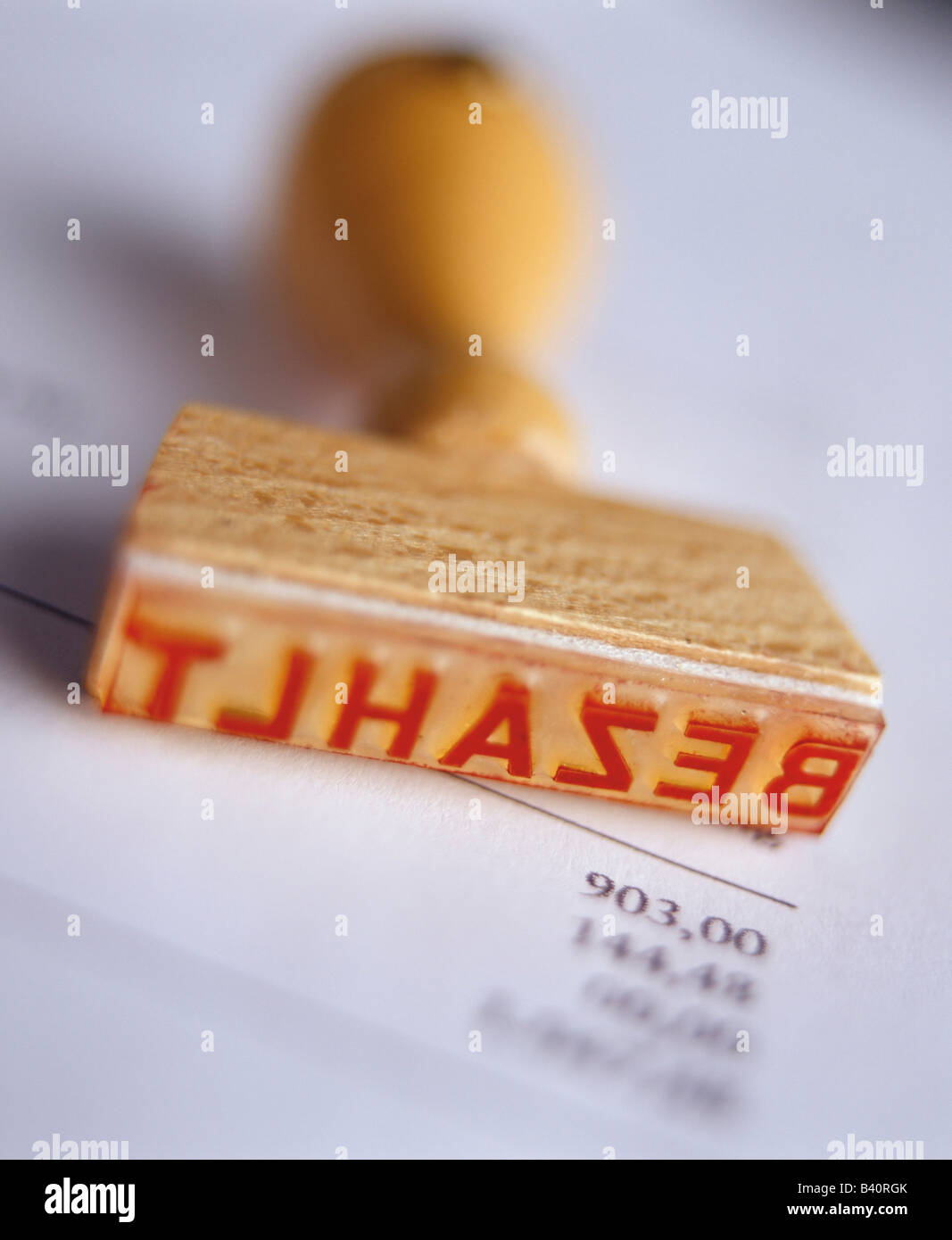 Paid stamp on an invoice - Stock Image