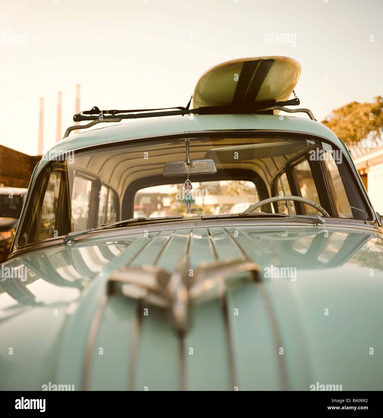 A vintage Pontiac stationwagon with a surfboard on top, parked along the Embarcadero, Morro Bay, California. - Stock Image