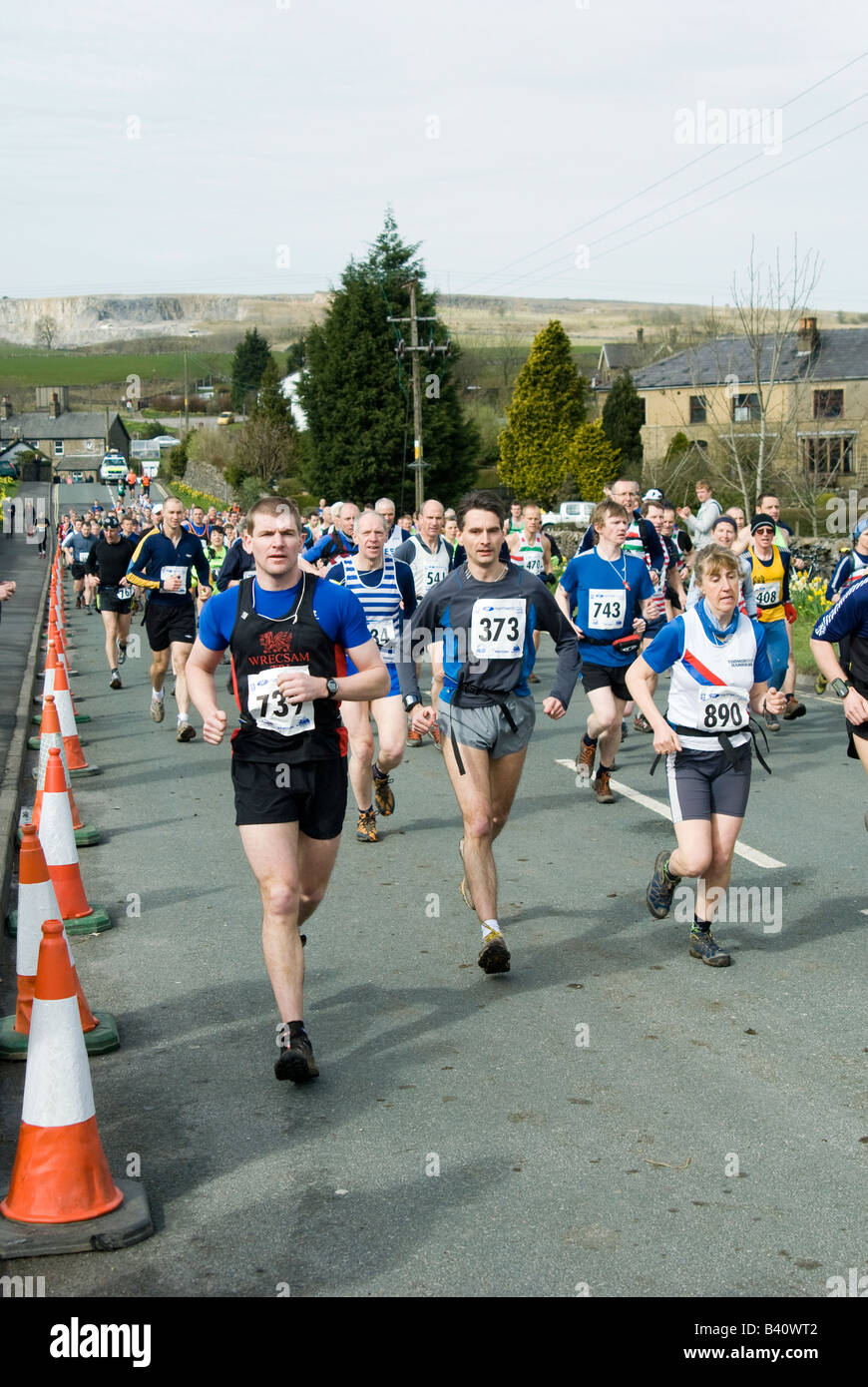 Runners competing in the three peaks long distance race challenge in Yorkshire England - Stock Image