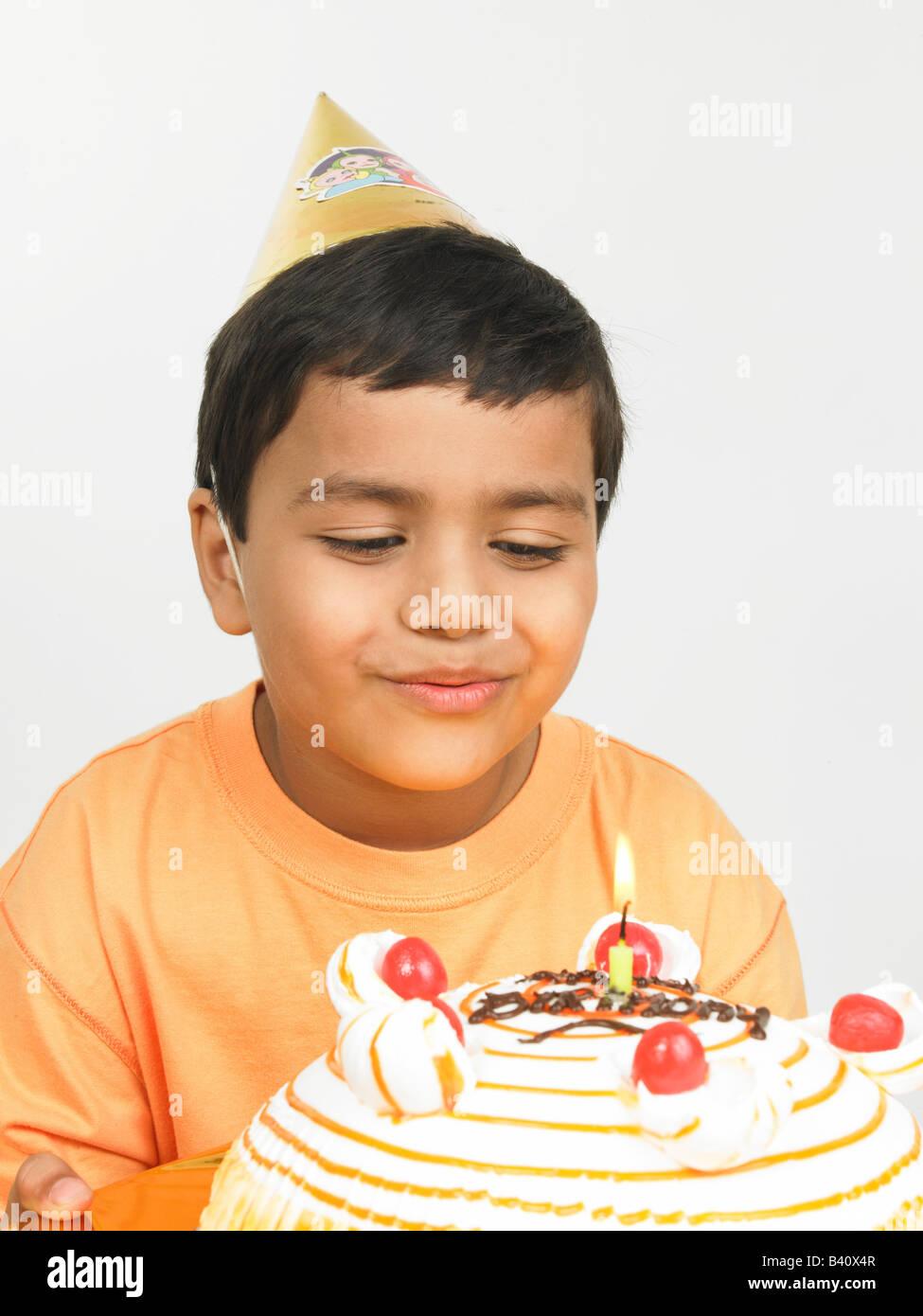 Surprising Asian Boy Of Indian Origin With His Birthday Cake Wearing Orange Funny Birthday Cards Online Chimdamsfinfo