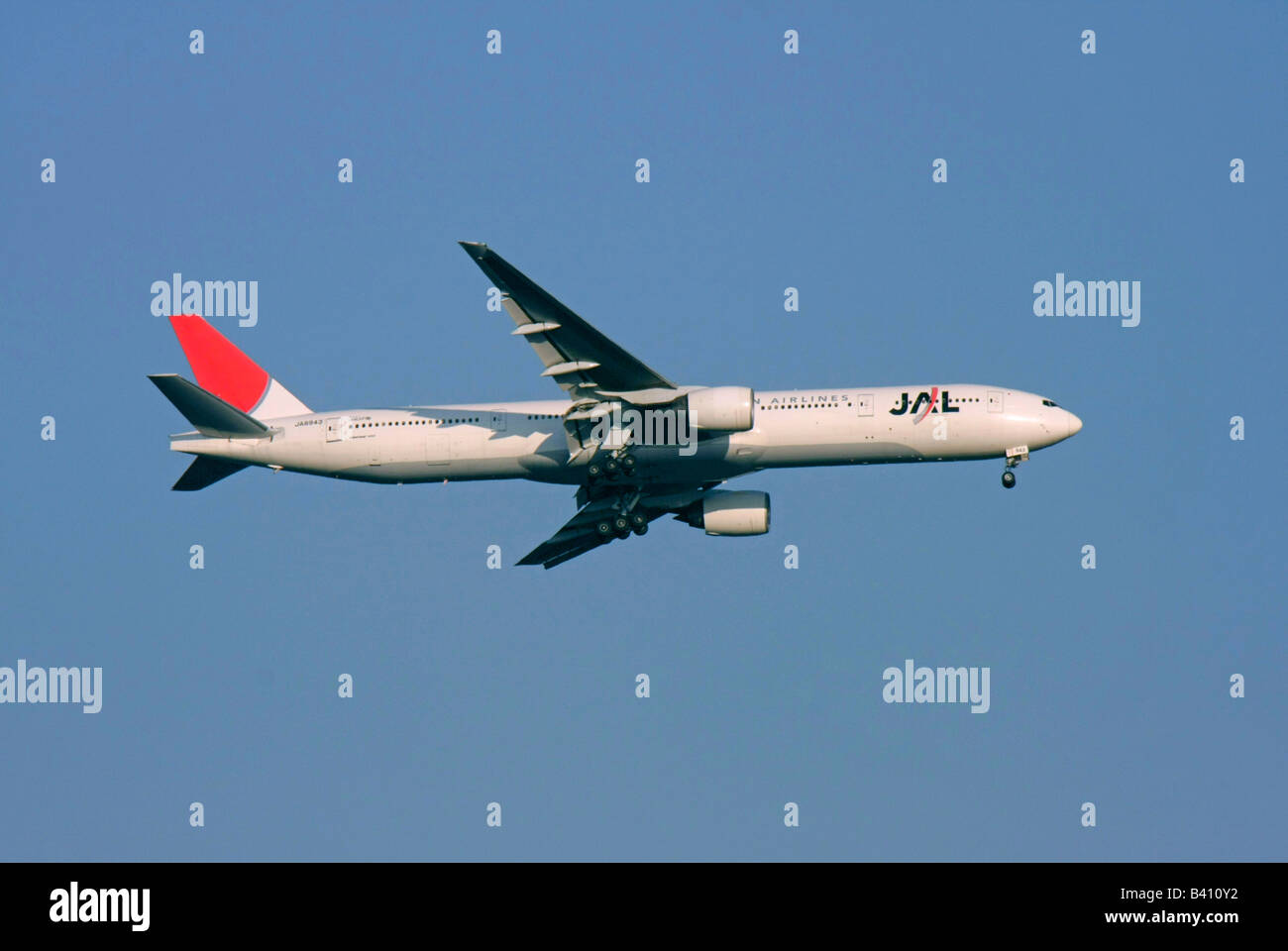 Japan Airlines Boeing 777 passenger aircraft is approaching to land Tokyo Japan - Stock Image